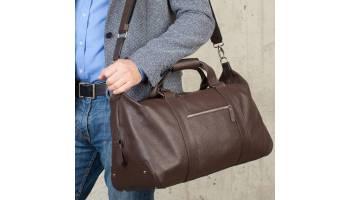 Как выбрать дорожную кожаную сумку? Советы по уходу